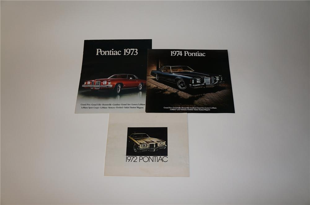 Lot of three Pontiac complete line showroom sales brochures for 1972,1973, and 1974. - Front 3/4 - 154583