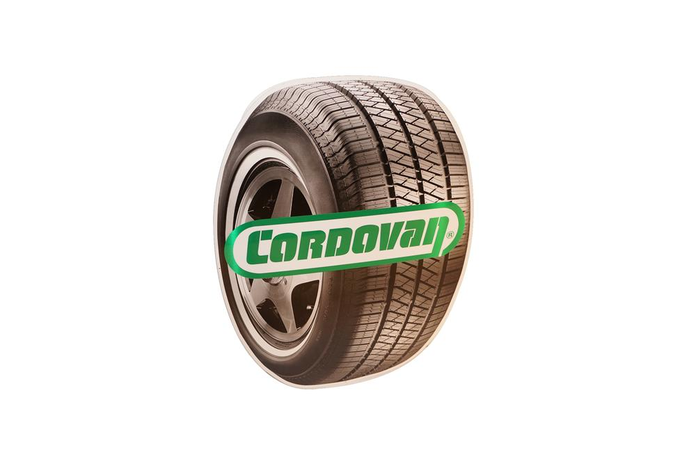N.O.S. Cordovan Tires single-sided tire shaped tin sign. - Front 3/4 - 154613