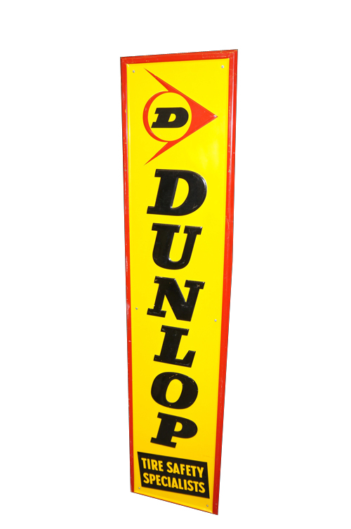 """Choice late 1950s-60s Dunlop """"Tire Safety Specialists"""" self-framed embossed tin garage sign. - Front 3/4 - 154627"""