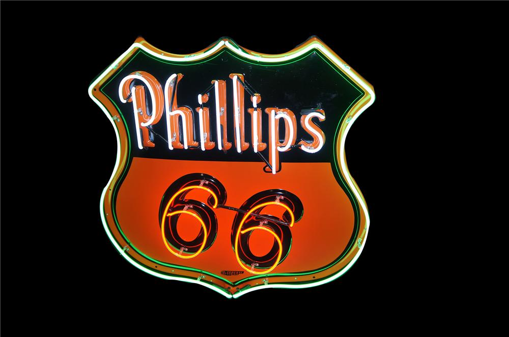 Marvelous 1957 Phillips 66 neon porcelain shield shaped service station sign.  Beautiful condition. - Front 3/4 - 158001