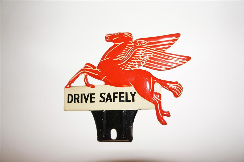 "N.O.S. 1940s Mobil Oil ""Drive Safely"" die-cut tin license plate attachment sign featuring the iconic ""Pegasus"". - Front 3/4 - 158070"