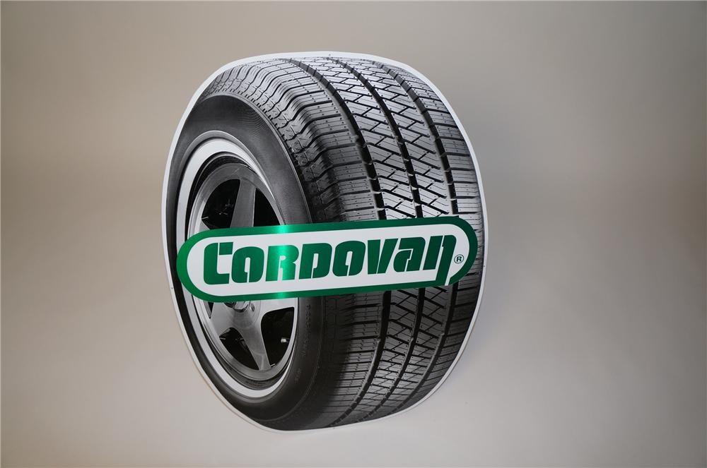 N.O.S. Cordovan Tires die-cut tin tire shaped garage sign.  Pulled out of the original shipping paper. - Front 3/4 - 158082
