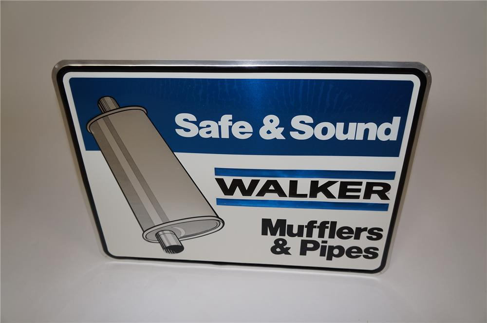 N.O.S. Walker Mufflers Safe and Sound embossed tin garage sign with muffler graphic. - Front 3/4 - 158110