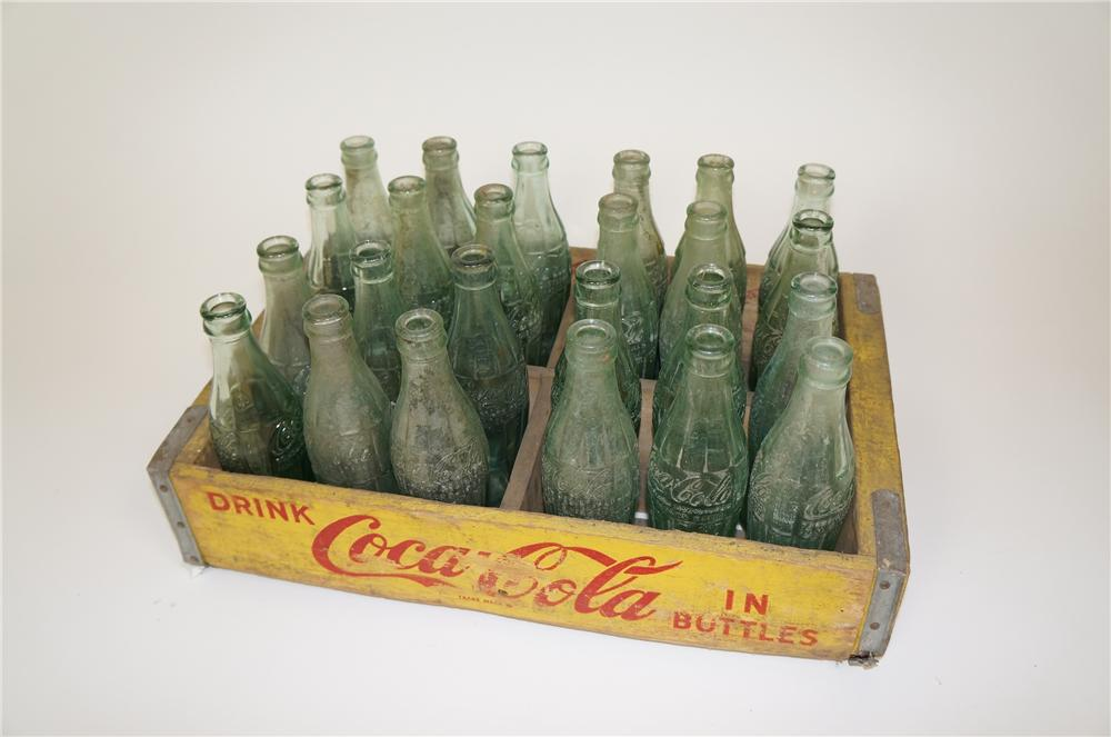 1950s Coca-Cola wooden crate of 24 period hobble skirt bottles with various bottling plants embossed on bottom. - Front 3/4 - 158194