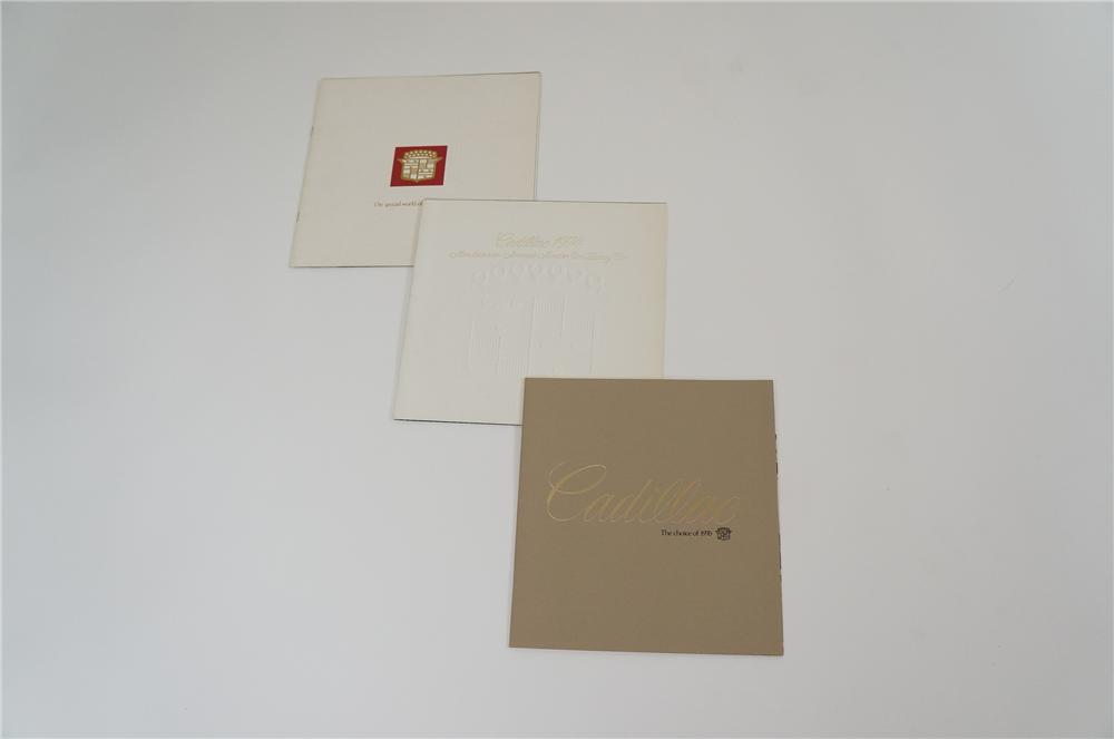 Lot of three N.O.S. Cadillac Showroom sales brochures for 1973, 1974 and 1976. - Front 3/4 - 158204