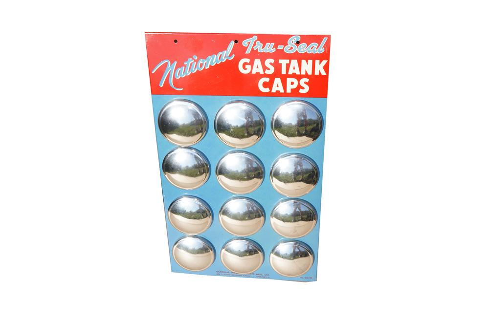 Choice N.O.S. 1950s National Tru-Seal Gas Tank Caps counter-top metal display with original gas caps intact. - Front 3/4 - 158232
