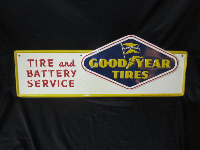 """Scarce 1950s Good Year Tires """"Tire and Battery Service"""" embossed die-cut tin garage sign. - Front 3/4 - 158304"""