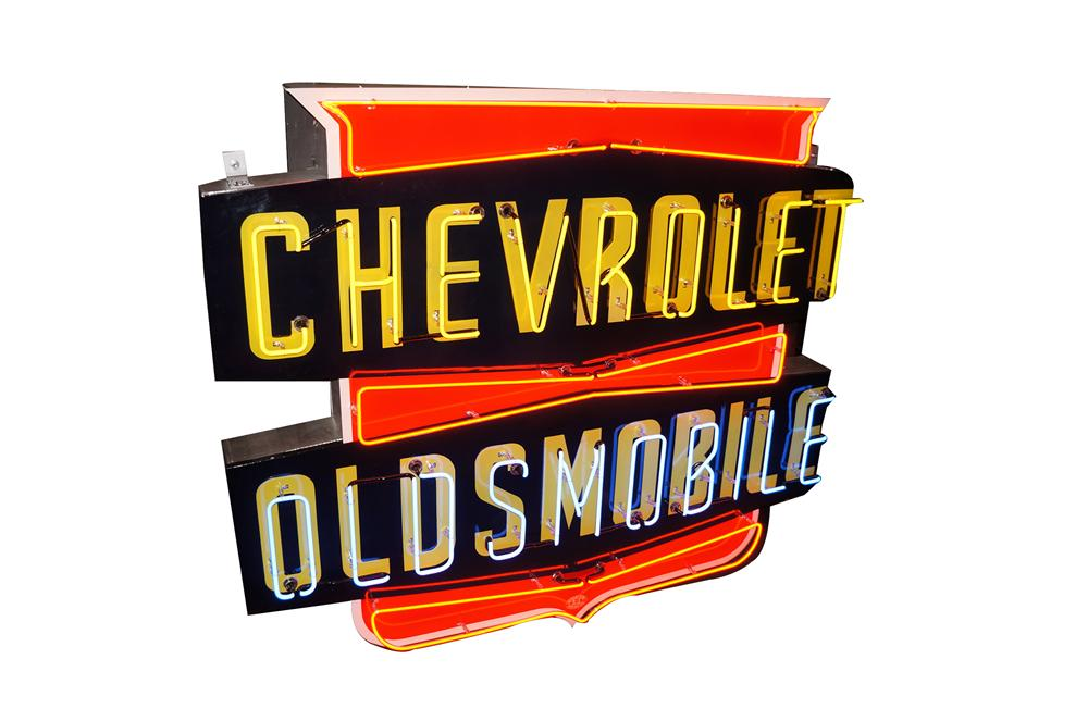 Simply spectacular and rare 1950's Chevrolet-Oldsmobile single-sided porcelain neon dealership sign. - Front 3/4 - 162101