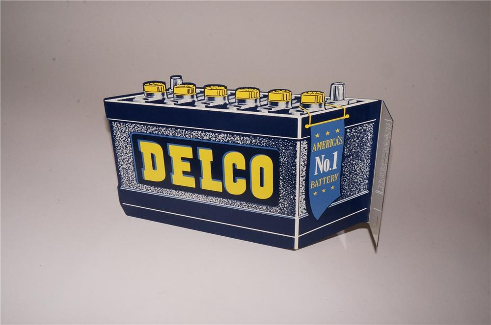 Rare small version N.O.S. 1950's GM Delco double-sided die-cut battery shaped tin sign. - Front 3/4 - 162480