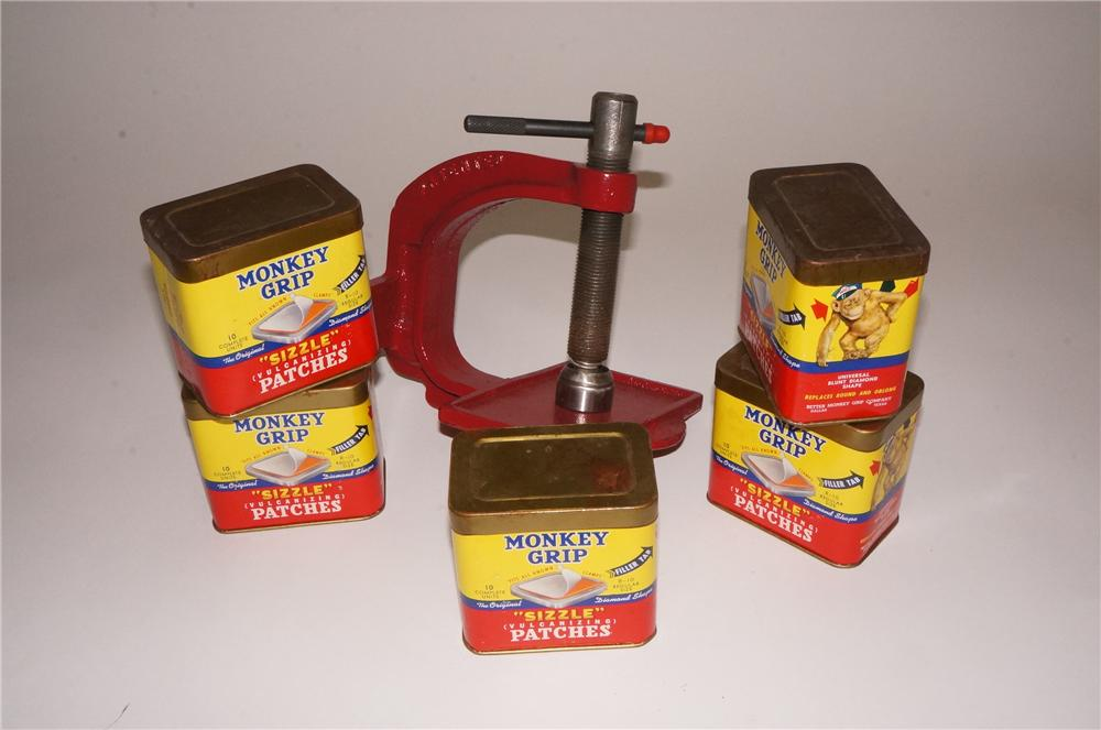 Set of five vintage 1950's Monkey Grip Tire/Tube Patch Repair tins with tire patch vise. - Front 3/4 - 162530