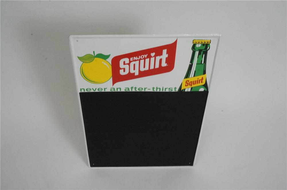N.O.S. 1960's Squirt Soda embossed tin menu board with bottle graphic.  Pulled out of the original shipping paper! - Front 3/4 - 162556