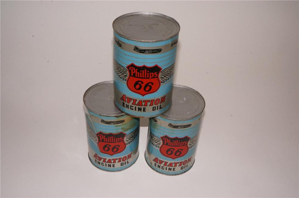 Lot of three 1950's Phillips 66 Aviation Oil metal quart cans still full and unused.  Great graphics! - Front 3/4 - 162563