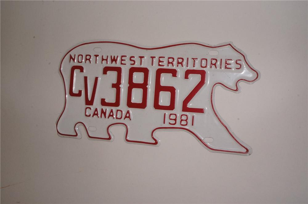 Neat Canadian Northwest Territories die-cut tin Polar Bear shaped license plate from 1981.  Very clean! - Front 3/4 - 162564