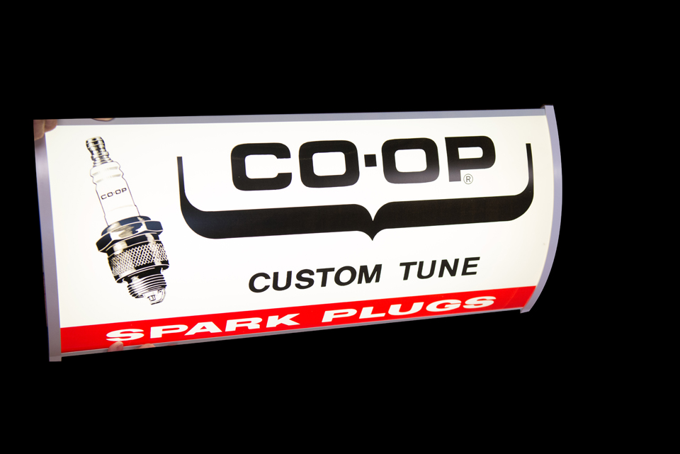 N.O.S. vintage Co-op spark plugs lighted automotive garage sign with spark plug graphics. - Front 3/4 - 162881
