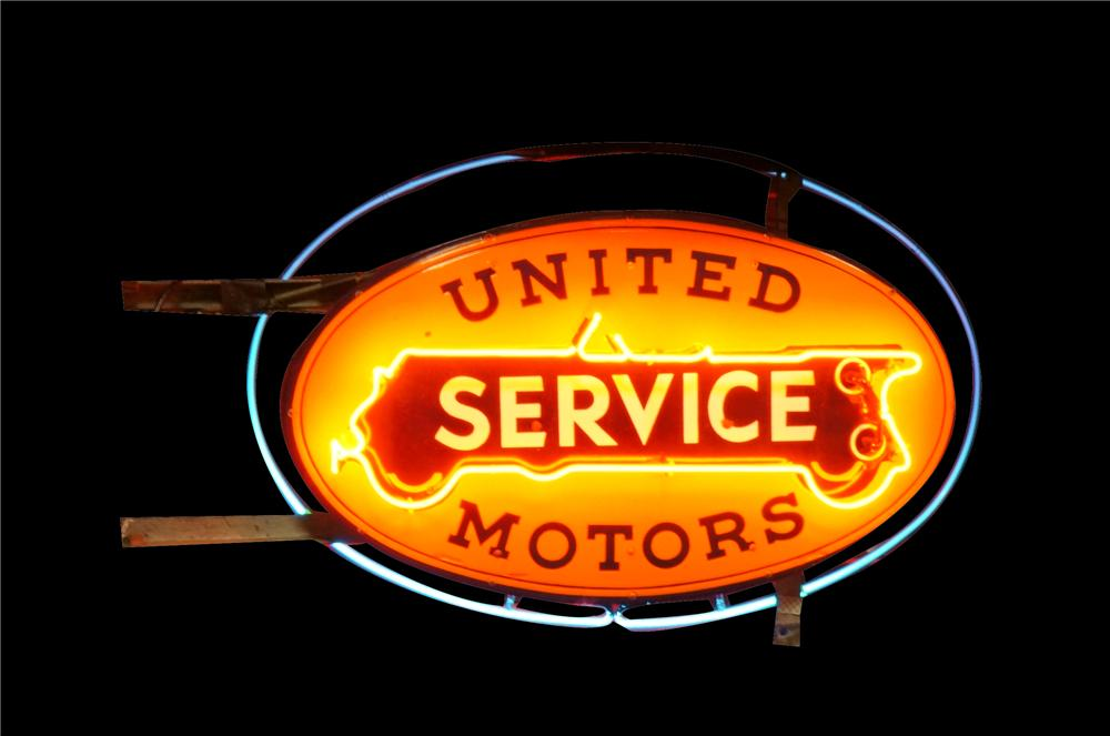 Very nice 1930's United Motors Service double-sided neon porcelain dealership sign. - Front 3/4 - 162978