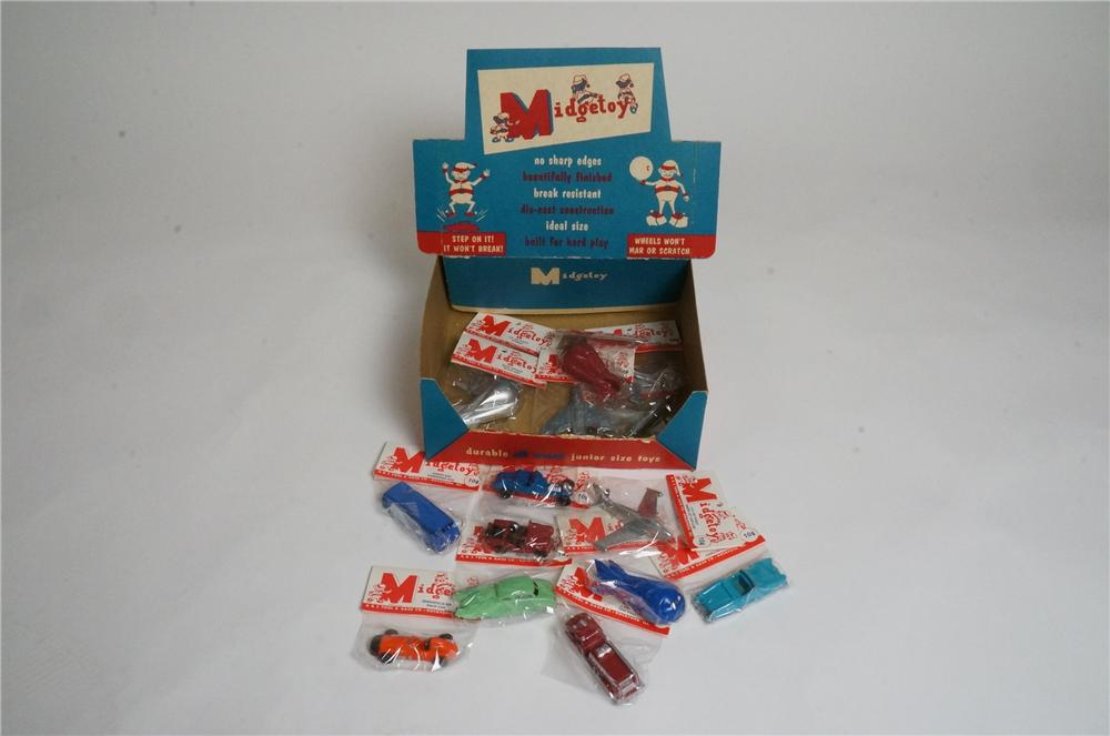 N.O.S. 1950's Midget Toys dime store/service station display filled with toys in the original wrappers. - Front 3/4 - 163008
