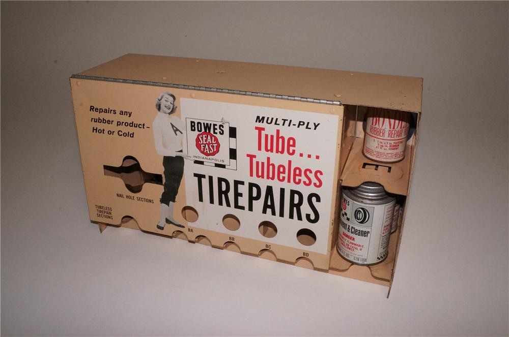 Fabulous 1950's Bowes Tire-Tube Repair tin with nice Bowes Cheerleader graphic. - Front 3/4 - 163139