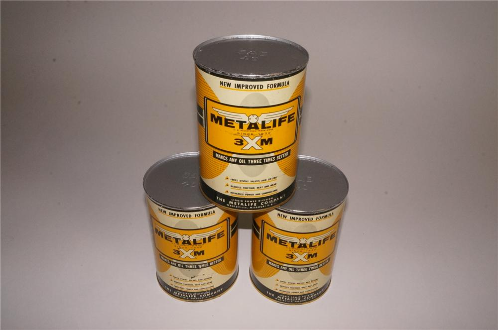Lot of three very clean 1950's Metalife oil additive metal quart cans. - Front 3/4 - 163140