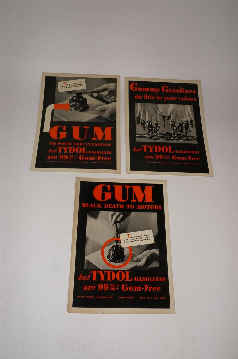 "Lot of three 1930's Tydol ""Gum - Black Death to Motors"" service station display cardboard signs. - Front 3/4 - 163145"