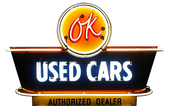 Worthy of bragging rights 1950's Chevrolet OK Used Cars double-sided neon porcelain dealership sign. - Front 3/4 - 163256