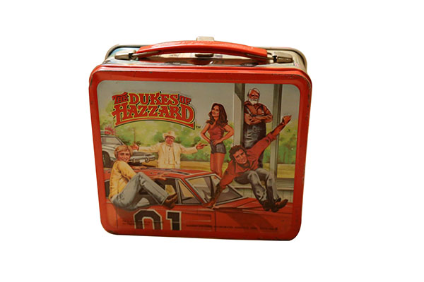 Circa 1979 The Dukes of Hazzard lunch box featuring the General Lee and Duke Boys.  A wonderful piece of Americana. - Front 3/4 - 163260