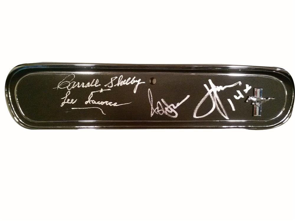 Superb 1965 Mustang glove box cover signed by Carroll Shelby, Lee Iacocca, John Force and Ashley Force. - Front 3/4 - 163311