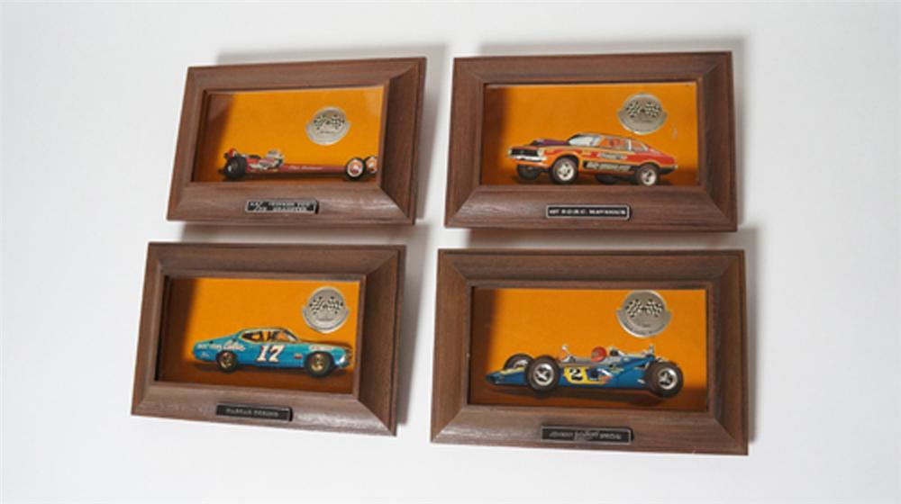 Killer 1970 set of four AutoLite dealership plaques featuring Al Unser, David Pearson, Don Nicholson, and Pete Robinson. - Front 3/4 - 170569