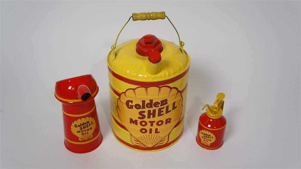 Set of three circa 1930's-50's Shell Oil service department multi fluid tins and handy oilers. - Front 3/4 - 170665