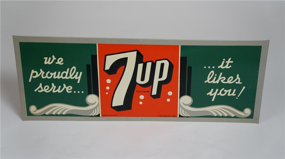 "Highly desirable 1944 ""We proudly serve 7-up Soda it likes you"" single-sided embossed tin sign with nice period styling. - Front 3/4 - 174776"