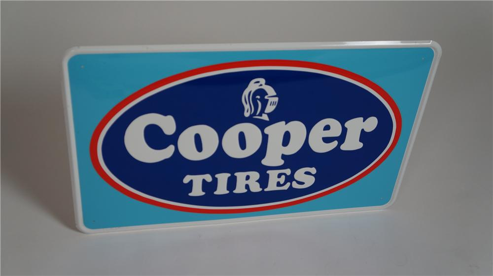 N.O.S. Cooper Tires single-sided embossed tin sign pulled out of the original shipping sleeve. - Front 3/4 - 174779