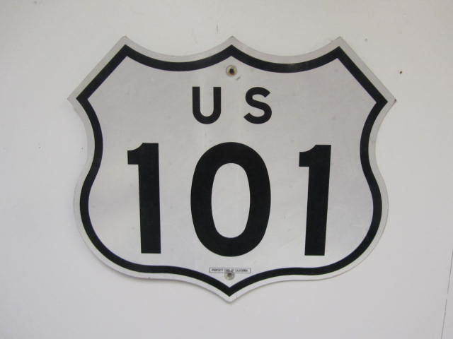 Highly prized California U.S. Highway 101 single-sided tin highway road sign. - Front 3/4 - 174871