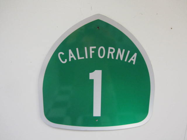 "Wonderful California State Route 1 ""AKA"" Pacific Coast Highway single-sided tin road sign. - Front 3/4 - 174873"