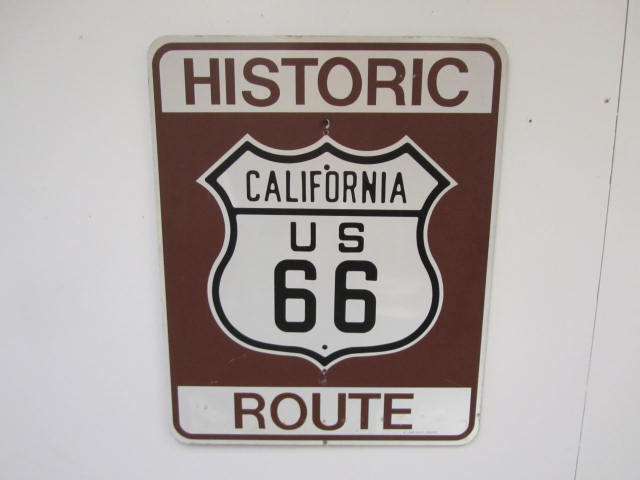 Coveted California Historic U.S. Route 66 single-sided tin highway road sign. - Front 3/4 - 174874