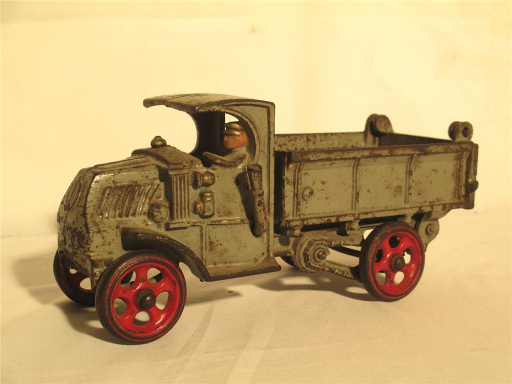 1931 Hubley cast iron Mack Dump Truck and Driver with original cast wheels and working dump bed. - Front 3/4 - 174891