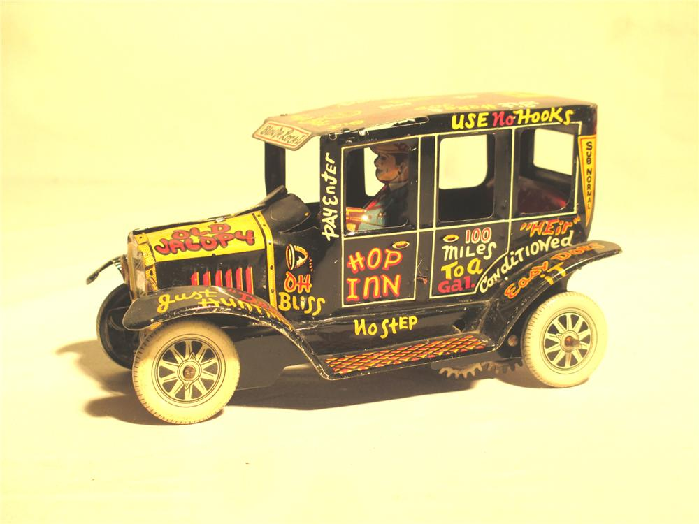 """Wonderful 1940's Marx """"Old Jalopy"""" tin light sedan complete with driver and neat graphics. - Front 3/4 - 174893"""