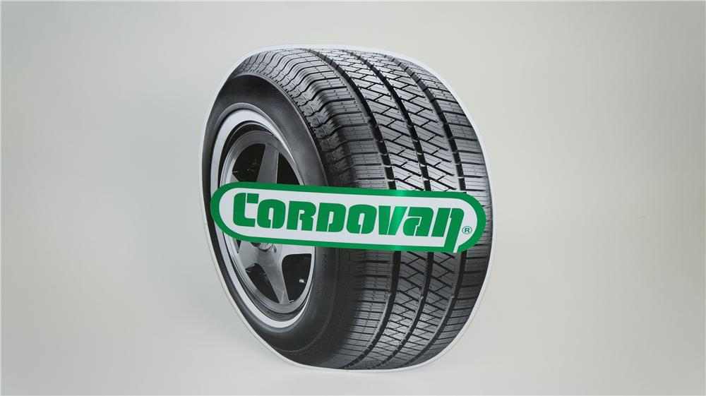 N.O.S. Cordovan Tires single-sided die-cut tin tire shaped garage sign. - Front 3/4 - 174906