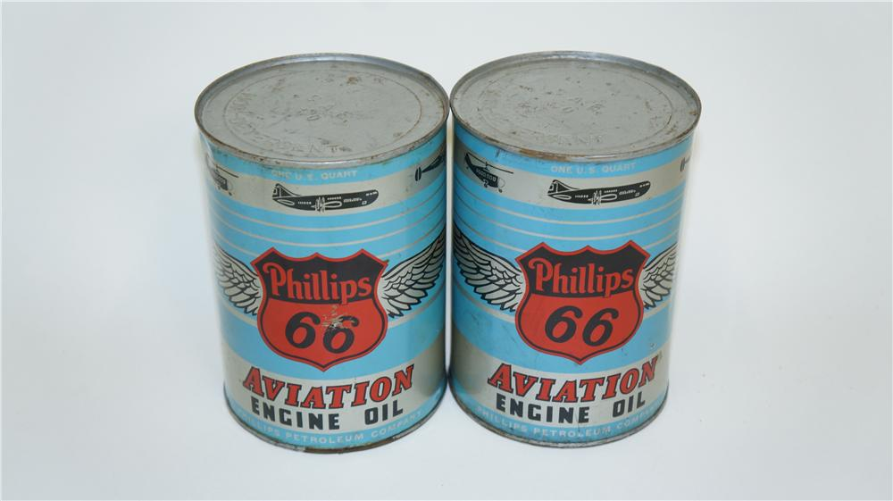Lot of two 1950's Phillips 66 Aviation Motor Oil metal quart cans with airplane graphics. - Front 3/4 - 174949