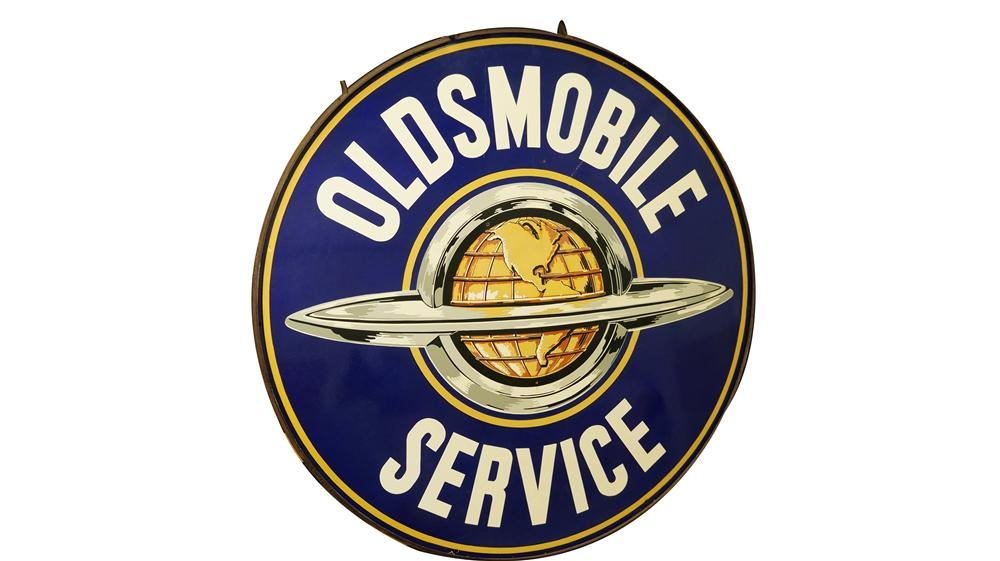 Phenomenal 1950's Oldsmobile Service double-sided porcelain dealership sign with world globe logo in original hanger. - Front 3/4 - 174968