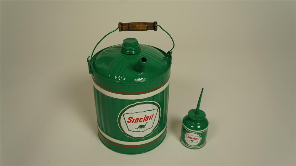Lot of two restored circa 1930's Sinclair Oil service department tins consisting of a gasoline/multi fluid can and handy oiler. - Front 3/4 - 174973