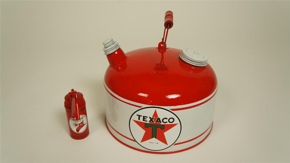 Lot of two circa 1930's-40's restored Texaco Oil service department tins consisting of a gas can and handy oiler. - Front 3/4 - 174976