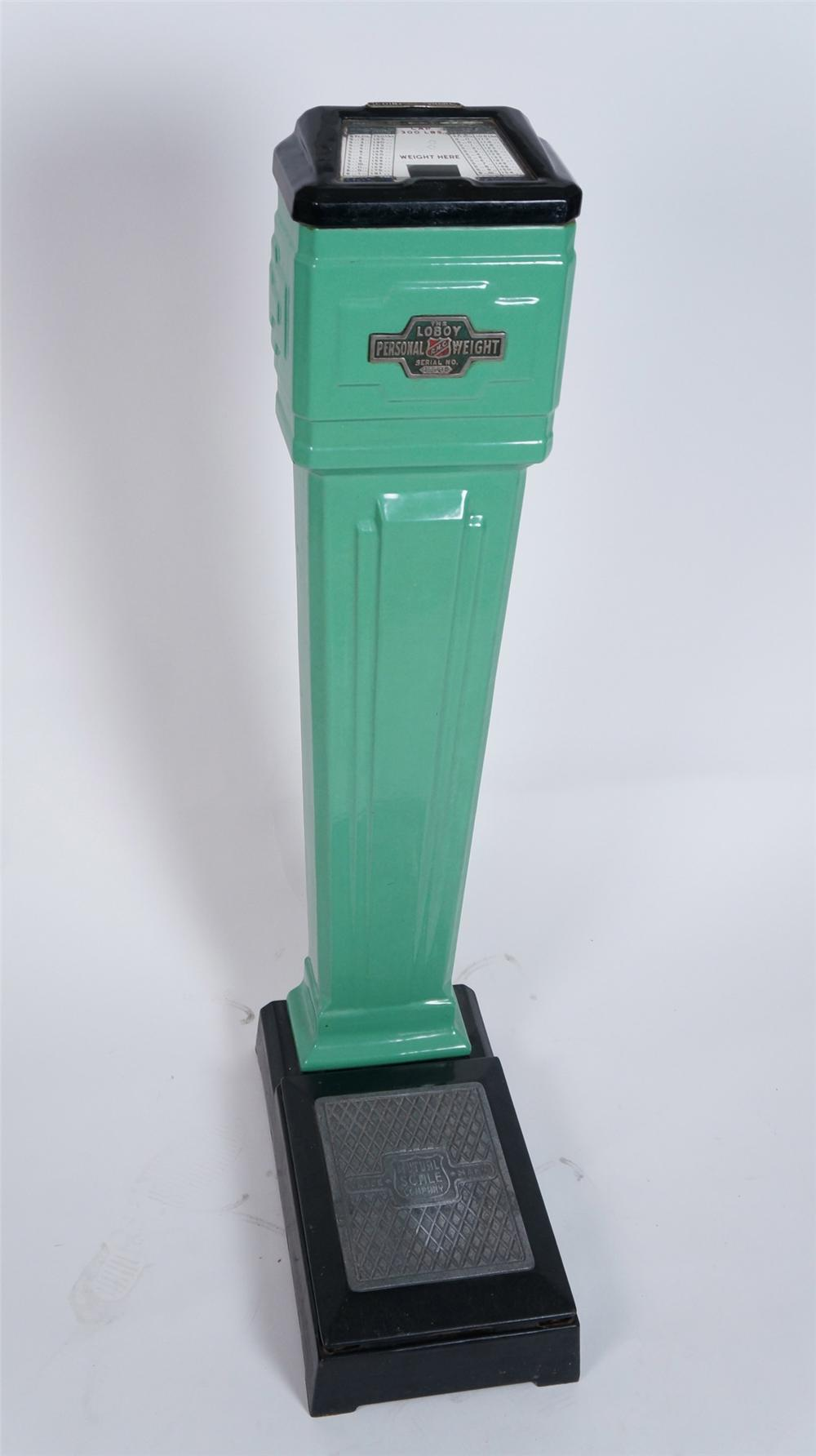 1930's Mutual Scale Company porcelain coated coin operated drug store/service station penny scale. - Front 3/4 - 175047