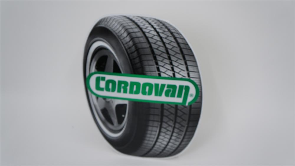 N.O.S. Cordovan Tires single-sided die-cut tin tire shaped automotive garage sign. - Front 3/4 - 177580