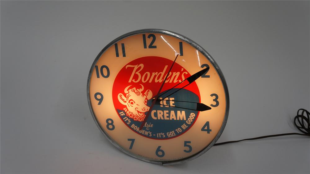Exceptional Borden's Ice Cream Pam glass faced light-up diner clock with Elsie the Cow graphics. - Front 3/4 - 177704