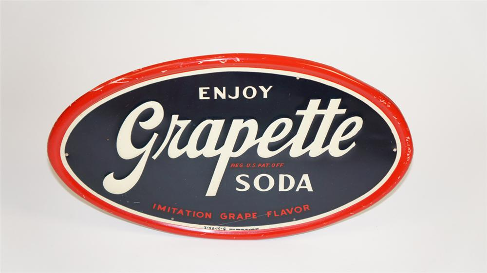 Highly prized 1948 Grapette Soda die-cut tin oval sign. - Front 3/4 - 177742
