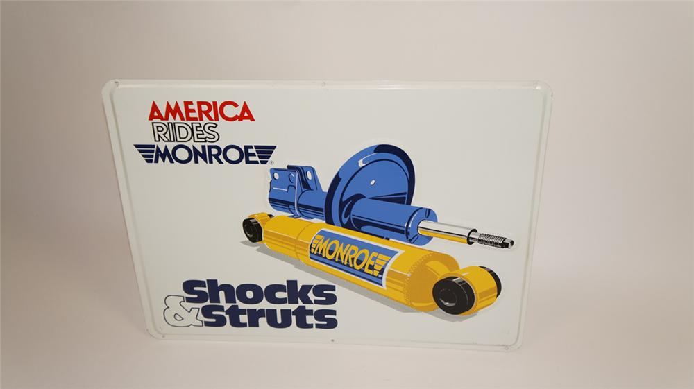 N.O.S. Monroe Shocks and Struts single-sided embossed tin automotive garage sign - Front 3/4 - 177749