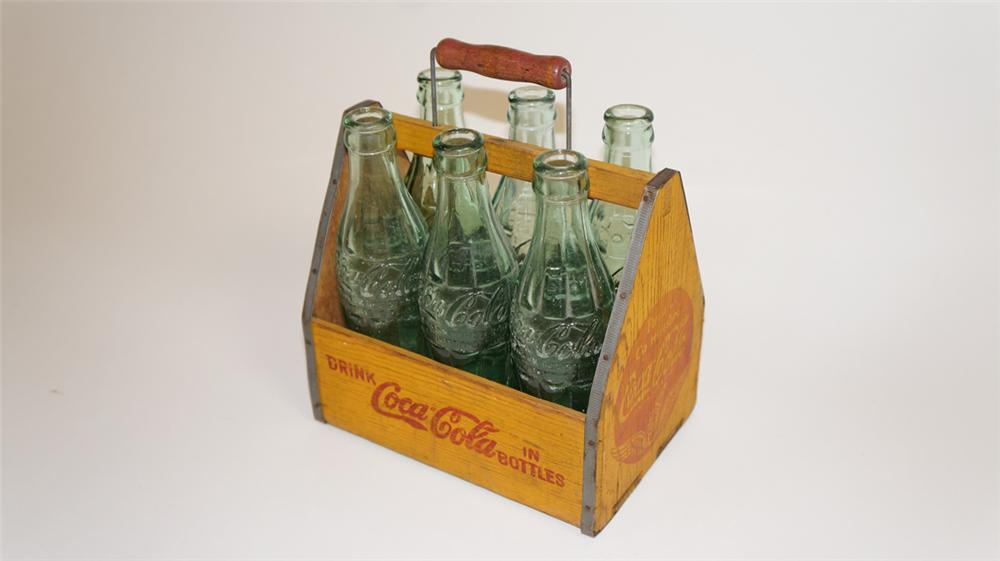 Choice late 1930's Coca-Cola wooden six pack carrier complete with six period hobble skirt bottles. - Front 3/4 - 177776