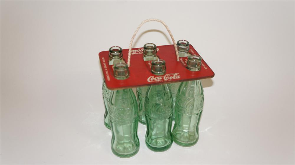 Out of the ordinary 1930's Coca-Cola masonite six pack carrier complete with six period hobble skirt bottles. - Front 3/4 - 177779