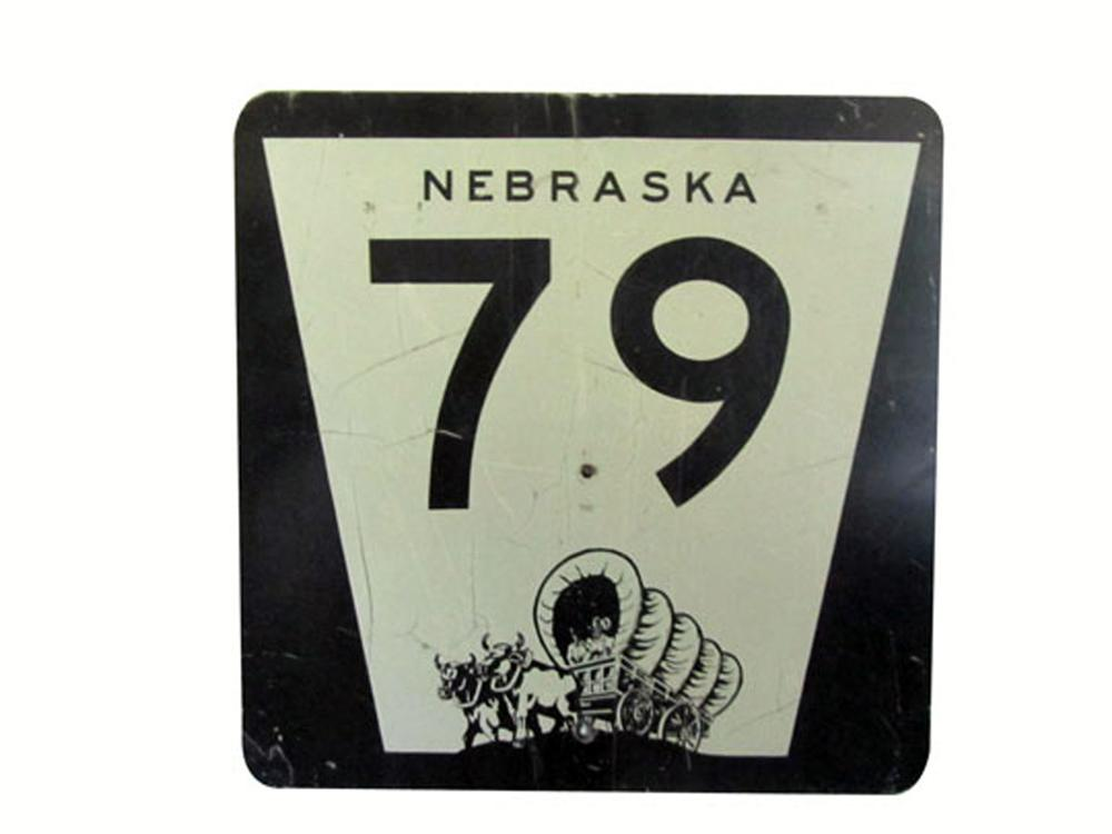 Neat vintage Nebraska Highway 79 metal road sign with Pioneer covered wagon logo. - Front 3/4 - 177935