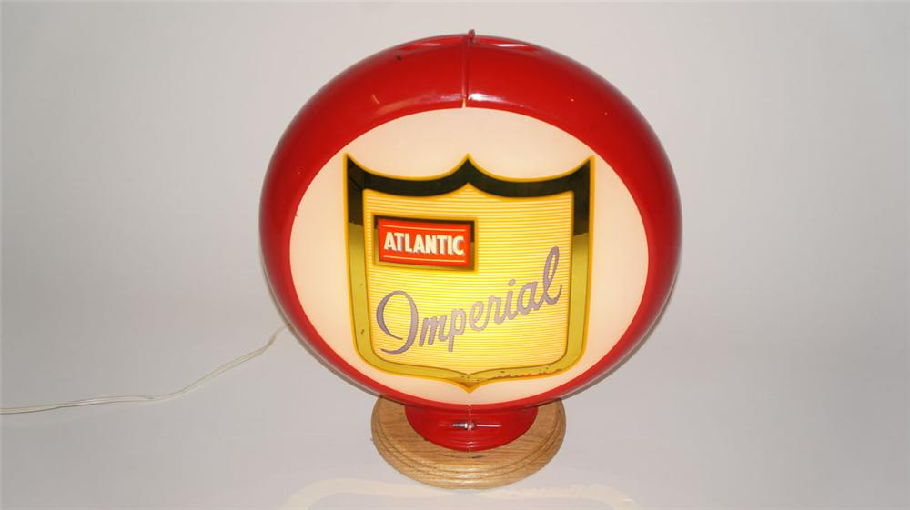 Gorgeous 1950's Atlantic Imperial Gasoline glass lensed gas pump globe in a Capcolite body. - Front 3/4 - 177961