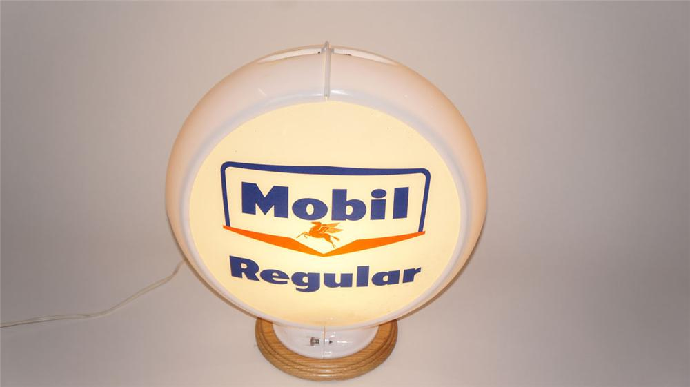 Late 1950's Mobil Regular Gasoline glass lensed gas pump globe in a Capcolite body. - Front 3/4 - 177967
